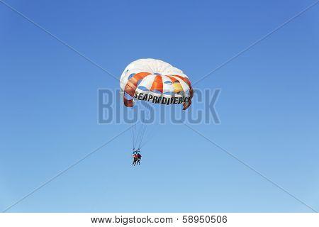 Parasailing in a blue sky in Punta Cana, Dominican Republic
