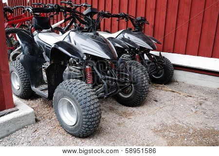 Two Atvs Outdoor Near The House
