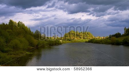 Spring Landscape Against The Thunderclouds