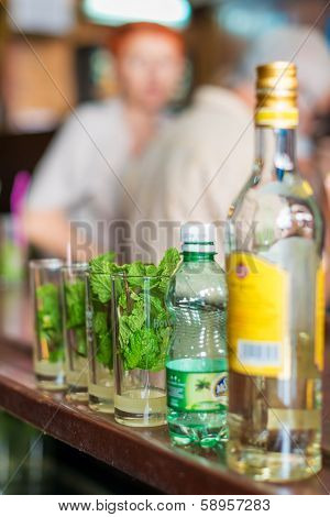 HAVANA,CUBA -?? JANUARY 20, 2014:Mojitos,a well known cuban cocktail being prepared at La Bodeguita del Medio.This world famous restaurant was a favorite of celebrities such as Ernest Hemingway
