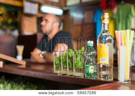 HAVANA,CUBA - JANUARY 20, 2014:Mojitos,a well known cuban cocktail being prepared at La Bodeguita del Medio.This world famous restaurant was a favorite of celebrities such as Ernest Hemingway