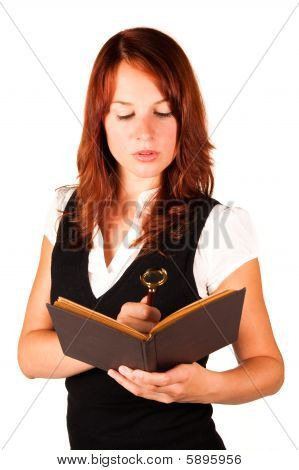 Woman Looking Into Book With Magnifying Glass