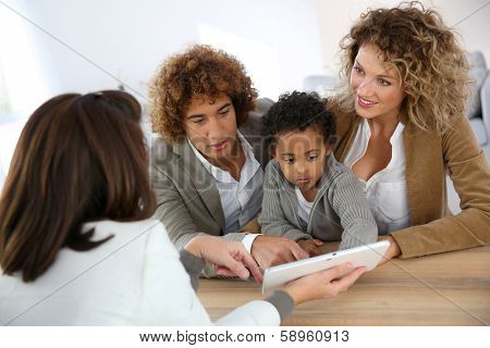 Family meeting real-estate agent for home purchase