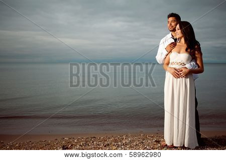 Young attractive happy couple posing outdoor.