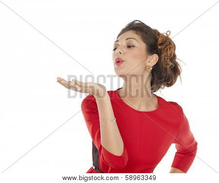 Beautiful girl sends an air kiss, blows on a palm, isolated on white