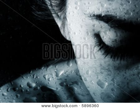Woman And Drops Of Rain