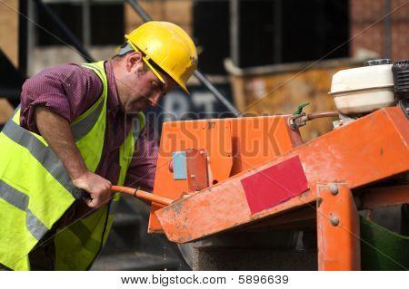 Builder Cutting Breeze Blocks With Still Saw