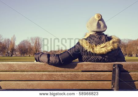 woman resting on a park bench