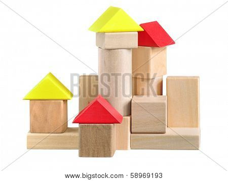 Building made of wooden blocks toy. Isolated with path on white.
