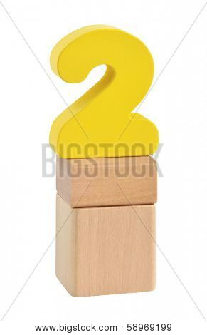 Number two made of wooden blocks toy. Isolated on white background with path.