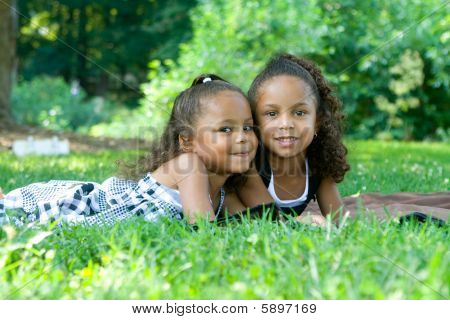 Two Beautiful Mixed Race Sisters Enjoying The Park