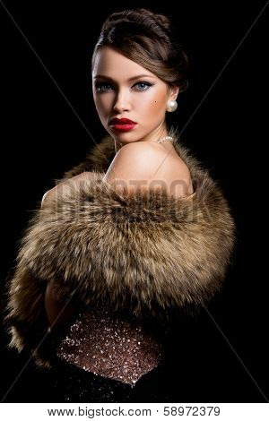 Vintage. Beautiful woman with fur