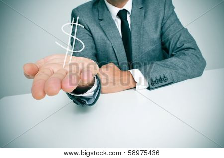a businessman sitting in a desk showing a drawn dollar sign in his hand
