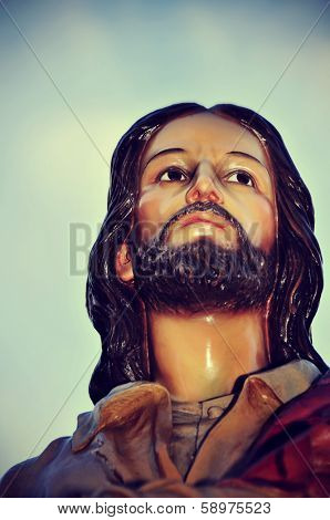 closeup of an old sculpture of Jesus