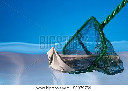 Economy Recovery Concept: Dollar boat saved by a fishing net
