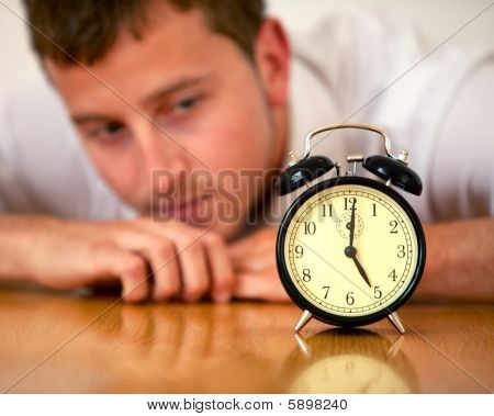 Business Man Looking At A Clock