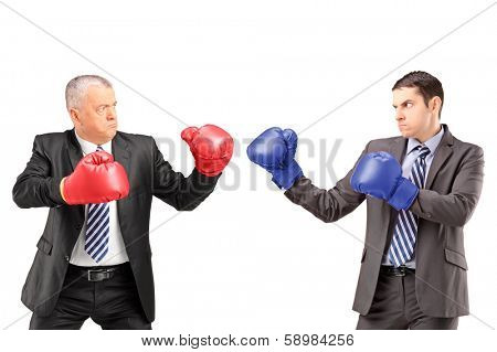 Mature businessman with red boxing gloves ready to fight his coworker isolated on white background