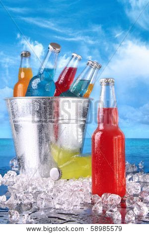 Cold summer drinks in ice bucket on the beach