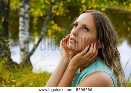 Beautiful Young Woman Relaxing On Nature.