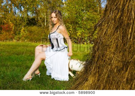 Beautiful Young Woman And Haystack.