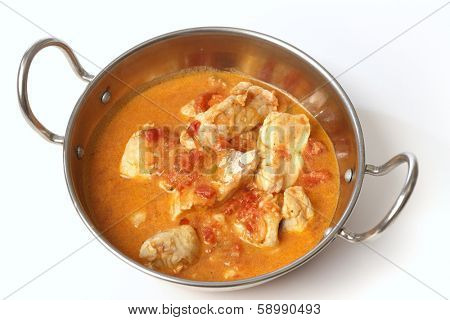 Basic fish curry, in a spicy tomato and coconut milk sauce, in a kadai (karahi or wok) serving bowl