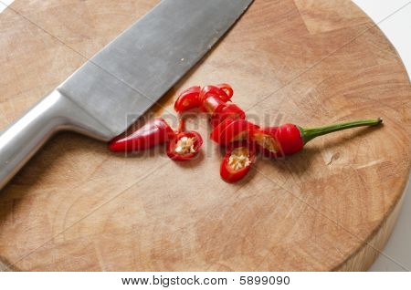 Chilli Pepper And Knife On Chopping Board