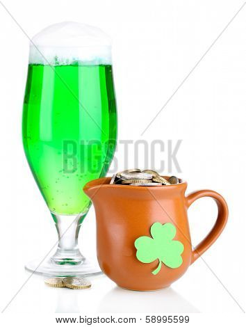 Glass of green beer and pitcher with coins isolated on white