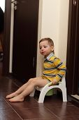 Child Sitting On Potty