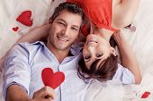 stock photo of two hearts  - smiling rose bed lying lovers - JPG