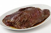 image of flank steak  - Two pieces of marinded flank steak resting on a plate prior to grilling - JPG