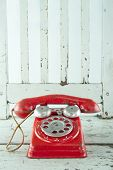 stock photo of toy phone  - Red toy telephone on light blue wooden vintage chair - JPG