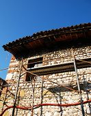 Old Stone Farmhouse With Scaffolding
