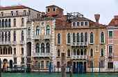 picture of winter palace  - Canal Grande view with beautiful palaces and poles for gondolas in cold winter day - JPG