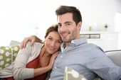 foto of 35 to 40 year olds  - Sweet couple relaxing in sofa at home - JPG
