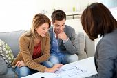 foto of family planning  - Couple meeting architect for house construction - JPG