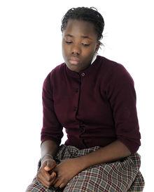 stock photo of tween  - An attractive tween schoolgirl looking mighty sad - JPG