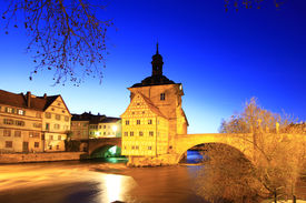 stock photo of regnitz  - The Old Town Hall of Bamberg Bavaria Germany inmidst the river Regnitz at night - JPG