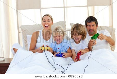 Loving Family Playing Video Game