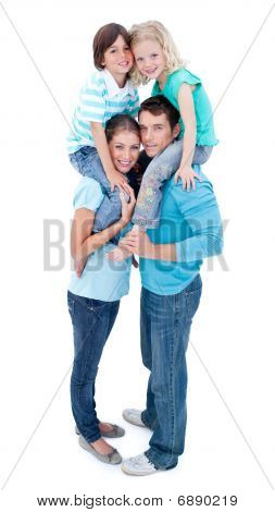 Portrait Of Family Enjoying Piggyback Ride