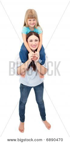 Cheerful Brunette Mother Giving Her Daughter Piggyback Ride