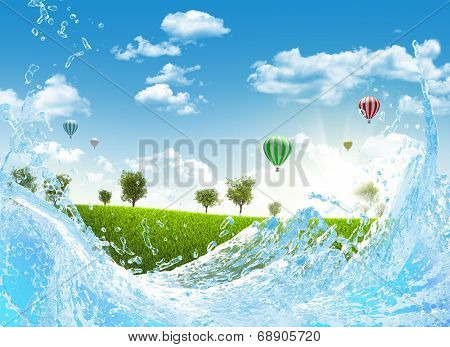 Trees on green meadow and water splash