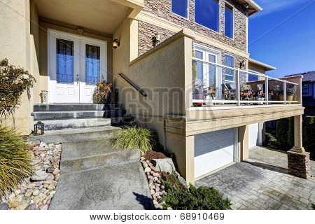 House Exterior. View Of Entrance Porch And Walkout Deck
