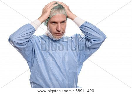 Depressed Surgeon In Scrubs