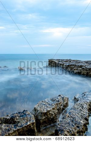 Nautical Background With A Rocky Seashore