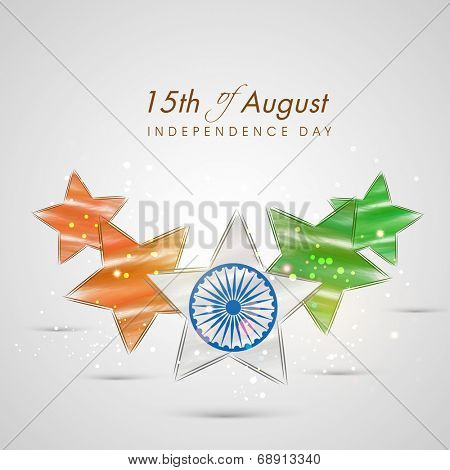 Beautiful stars in national tricolors with Ashoka Wheel on shiny grey background for 15th of August Indian Independence Day celebrations.