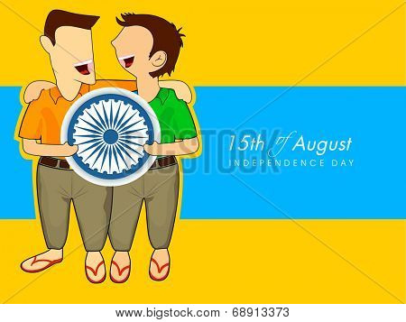 Happy young boys holding Asoka wheel on occasion of 15th of August, Indian Independence Day celebrations.