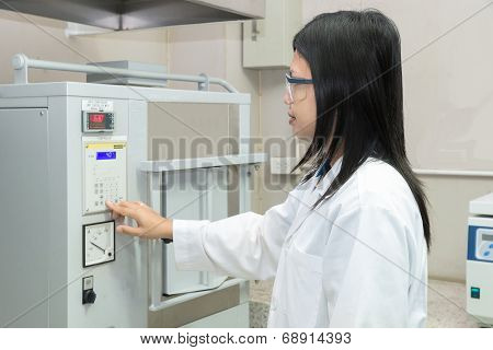 Scientists Using High Temperature Muffle Furnace In Laboratory