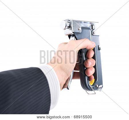 Staple Gun In Hand On A White Background
