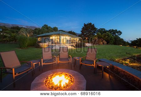 Luxury backyard fire pit at sunset