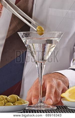 Bartender  preparing martini cocktail.Barman preparing cocktail